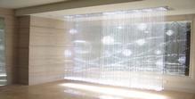 Un lustre type rideau de lumière scintillante